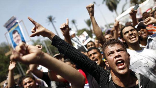 Para Mesir pendukung Ikhwanul Muslimin. (Foto AFP/ Khaled Mahmud)