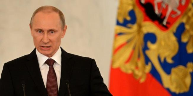 KIRILL KUDRYAVTSEV / AFP Presiden Rusia, Vladimir Putin saat berpidato di depan parlemen Rusia soal referendum Crimea, Selasa (18/3/2014). Usai berpidato, Putin menandatangani traktat yang meresmikan Crimea menjadi bagian dari Federasi Rusia.